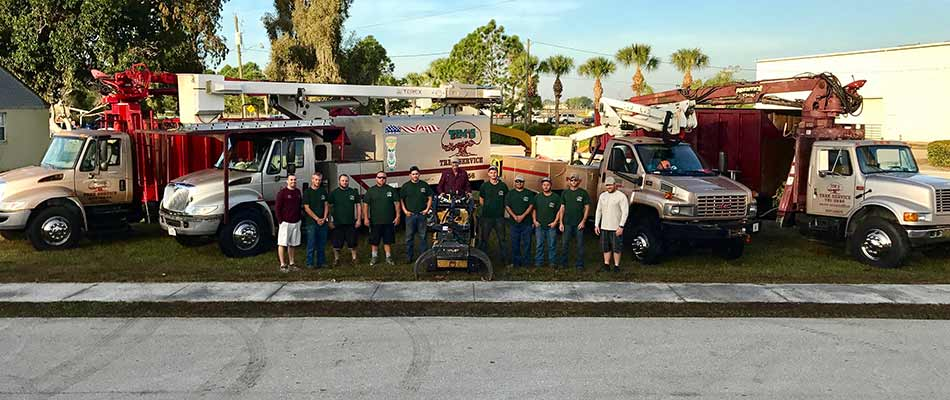 Tim's Tree Service work trucks and tree service crew in Lee County, FL.